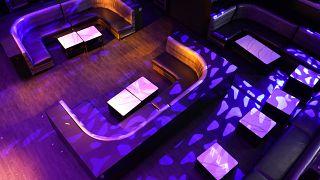Lights shine on an empty LIV nightclub Wednesday, Oct. 14, 2020, in Miami Beach, Florida.