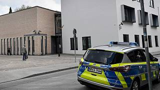 A police car stands in front of the synagogue in Gelsenkirchen, Germany, Thursday, May 13, 2021