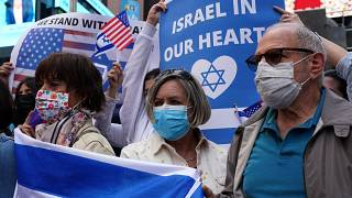 American Jewish groups gather in Times Square in New York, as rallies across America show solidarity with Israel.