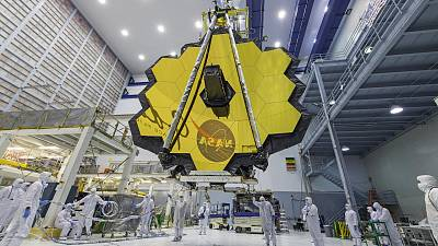 NASA technicians lift the mirror of the James Webb Space Telescope using a crane at the Goddard Space Flight Center .