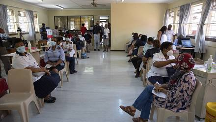 South African healthcare workers rush to beat deadline for Covid jab