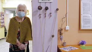 An elderly woman waits to receive a dose of the COVID-19 vaccine, at Nadezhda nursing home, in Sofia, Wednesday, Jan. 27, 2021