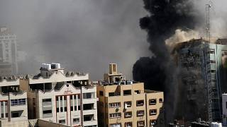 A view of a 11-story building housing AP office and other media in Gaza City is seen moments after Israeli warplanes demolished it, Saturday, May 15, 2021.