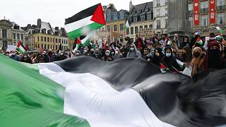 People hold Palestinian flags during a demonstration in Lille, northern France, Saturday May 15, 2021.