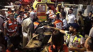 Paramedics tend to the wounded outside the synagogue in Givat Zeev, near Jerusalem