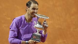 Spain's Rafael Nadal celebrates with the trophy after winning the Italian Open tennis tournament, in Rome