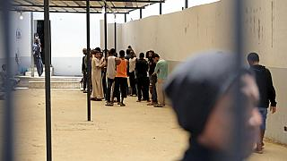 People gathered inside a Tripoli detention centre, pictured in May 2017