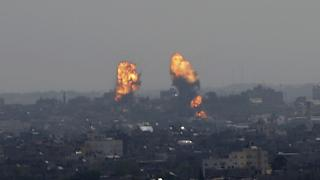 Flares rise after an Israeli forces strike in Gaza City