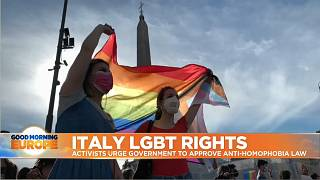 LGBTQ flag held up by activists in Central Rome, Italy