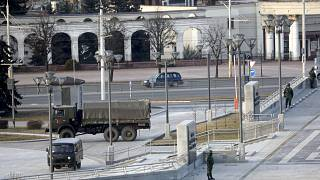 Belarusian interior ministry guard an empty street to prevent a rally in March.