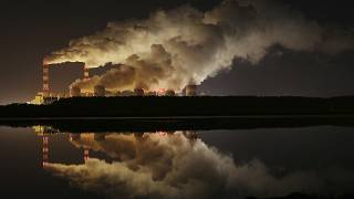 Plumes of smoke rise from Europe's largest lignite power plant in Belchatow, central Poland.