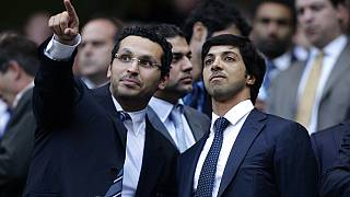 Manchester City's owner Sheikh Mansour, right, is seen with chairman Khaldoon Al Mubarak before his team's English Premier League soccer match against Liverpool