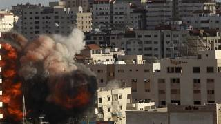 An Israeli air strike hits a building in Gaza City, Monday, May 17, 2021.