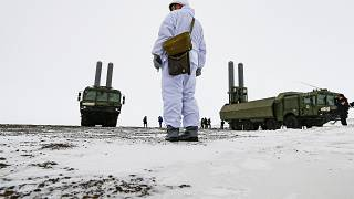 An officer stands as the Bastion anti-ship missile systems take positions on the Alexandra Land island near Nagurskoye, Russia, Monday, May 17, 2021.