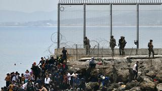 Spain steps up pressure on Morocco after record migrant influx
