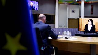 European Council President Charles Michel, left, speaks with Georgian President Salome Zurabishvili, on screen, during a video conference at the European Council on April 19