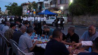 Palestinian Muslims break their fast while Israeli settlers gather in the neighbourhood of Sheikh Jarrah
