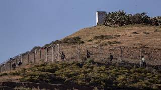 Spain police fire tear gas towards migrants at Morocco border