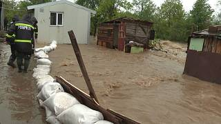 Rescue teams building sand sacks dam