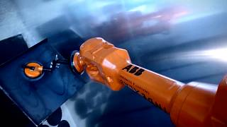 An ABB robot demonstrates it's automated building capabilities.