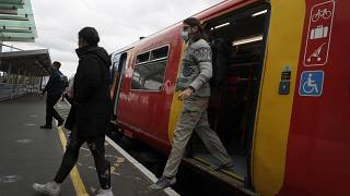 Passengers step off a train in London, Thursday, May 20, 2021.