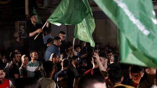 Los palestinos de Gaza celebran el alto el fuego entre Israel y Hamás