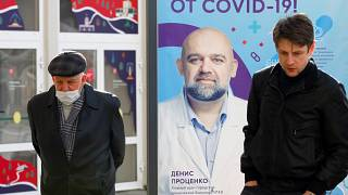 """Moscow: poster showing a portrait of Dr. Denis Protsenko and words reading """"Get vaccinated against covid-19!!"""""""