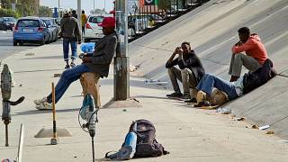 Facing a long and uncertain wait, migrants work odd jobs in Libya