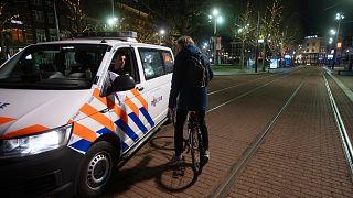 Dutch police  in the center of Amsterdam, Saturday, Jan. 23, 2021.
