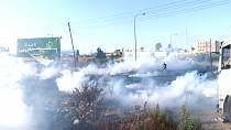 Palestinians rally near DCO checkpoint in Ramallah