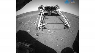 A landing platform and the surface of Mars are seen from a camera on the Chinese Mars rover Zhurong.