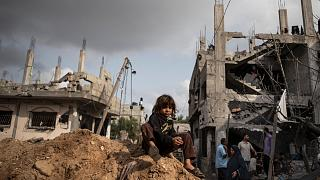 Palestinians in Beit Hanoun, northern Gaza Strip, inspect the damage to their homes following a cease-fire, Friday, May 21, 2021. (AP Photo/Khalil Hamra)