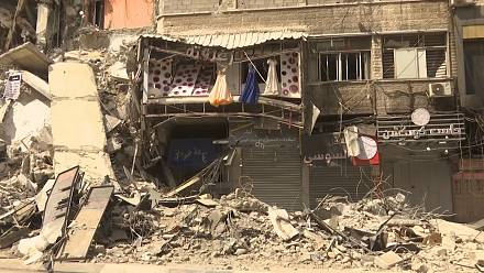 Shopkeepers view damage on commercial street in Gaza