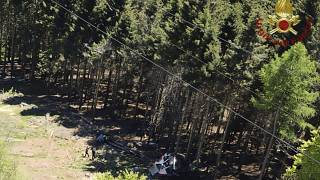 The wreckage of a cable car is seen on the ground after it collapsed near the summit of the Stresa-Mottarone line in the Piedmont region, northern Italy, May 23, 2022.