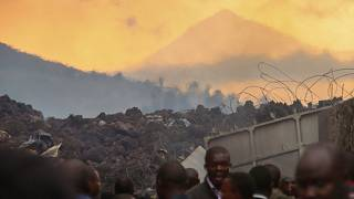 Residents check the damages caused by lava from the overnight eruption of Mount Nyiragongo, on the outskirts of Goma, Congo in the early hours of Sunday, May 23, 2021