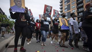 The family of Daunte Wright march for the one year anniversary of George Floyd's death on May 23, 2021, in Minneapolis, Minn.