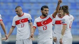 Turkey's Ozan Tufan celebrates during the 2022 FIFA World Cup qualifying match against Norway.