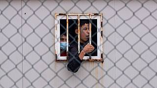 Children who crossed into Spain wait inside a temporary shelter in the enclave of Ceuta, next to the border of Morocco and Spain, Thursday, May 20, 2021.