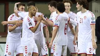 Denmark players celebrate a goal against Austria during their 2022 FIFA World Cup qualifying match.