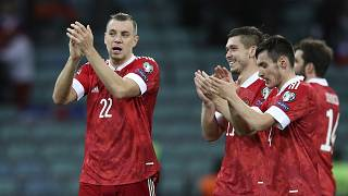 Russia's players celebrate after their FIFA 2022 World Cup qualifying match against Slovenia.