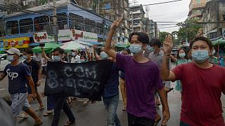 Anti-coup protesters flash the three-finger salute during a demonstration against the military takeover, in Yangon, Myanmar, Monday, May 24, 2021.