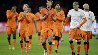 Netherlands' players cheer supporters at the end of their 2022 FIFA World Cup qualifying match against Latvia.