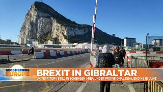 People walking across Gibraltar.