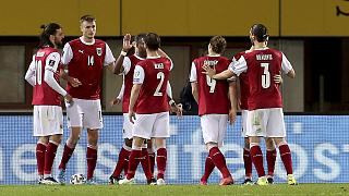 Austria's players react during their 2022 FIFA World Cup qualifying match against the Faroe Islands.