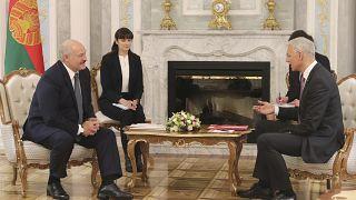 Belarusian President Alexander Lukashenko, left, and Prime Minister of Latvia Krisjanis Karins talk during their meeting in Minsk, Belarus, Thursday, Jan. 16, 2020.