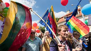 People hold flags and take part in the annual Baltic Gay Pride Parade in Vilnius, Lithuania, Saturday, June 18, 2016.
