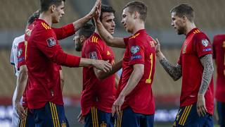 Spain players celebrate after scoring the opening goal during their 2022 FIFA World Cup qualifying match against Kosovo.
