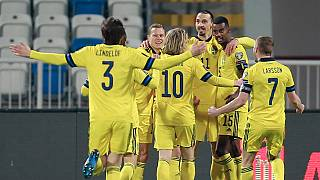 Sweden's players celebrate during the 2022 FIFA World Cup qualifying match against Kosovo.
