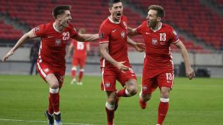 Robert Lewandowski celebrates after scoring Poland's third goal against Hungary during the 2022 FIFA World Cup qualifying match.
