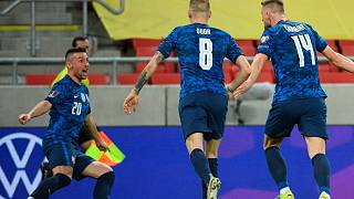 Slovakia's players celebrate their opening goal during the 2022 FIFA World Cup qualifying match against Russia.